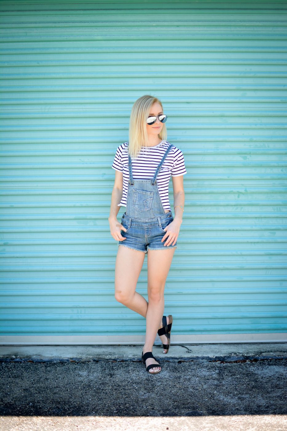 Overalls and a striped shirt