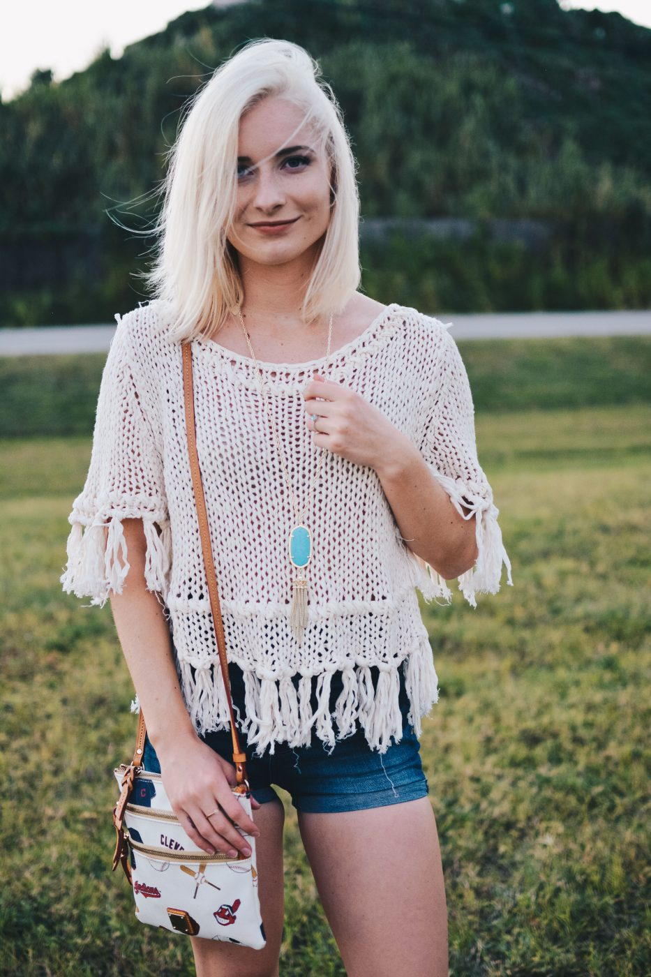 Fall Classic: Outfit. Free People top, high-waisted jean shorts, Dooney & Bourke Indians bag