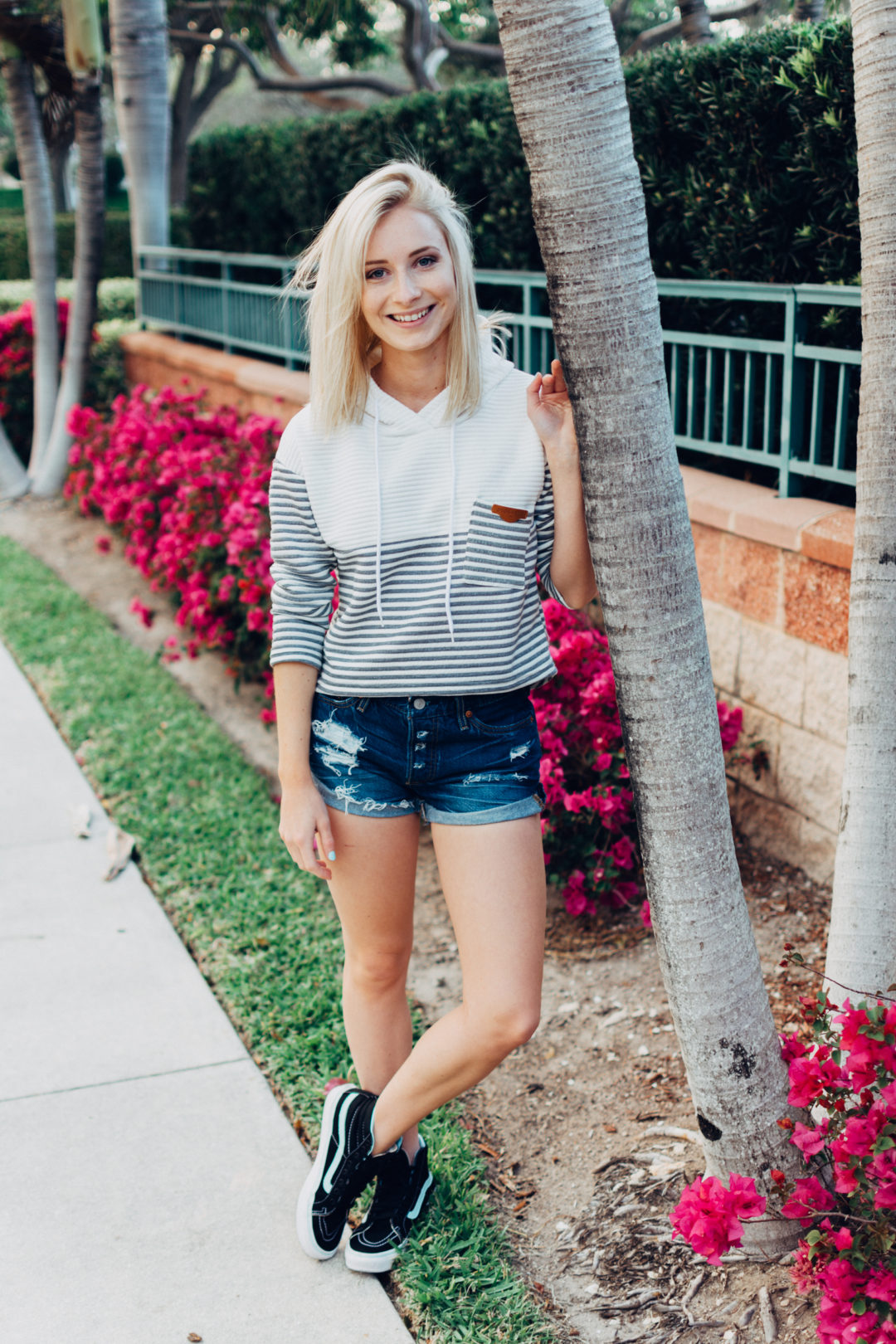 Jenny of Sweet Teal wearing striped Romwe sweatshirt, Levi's, and Vans