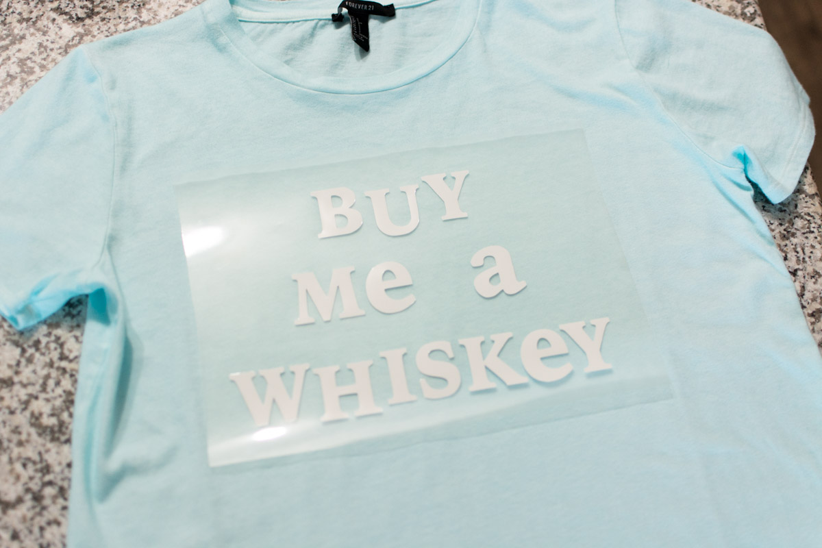 Buy Me A Whiskey Heat Transfer Vinyl Tee