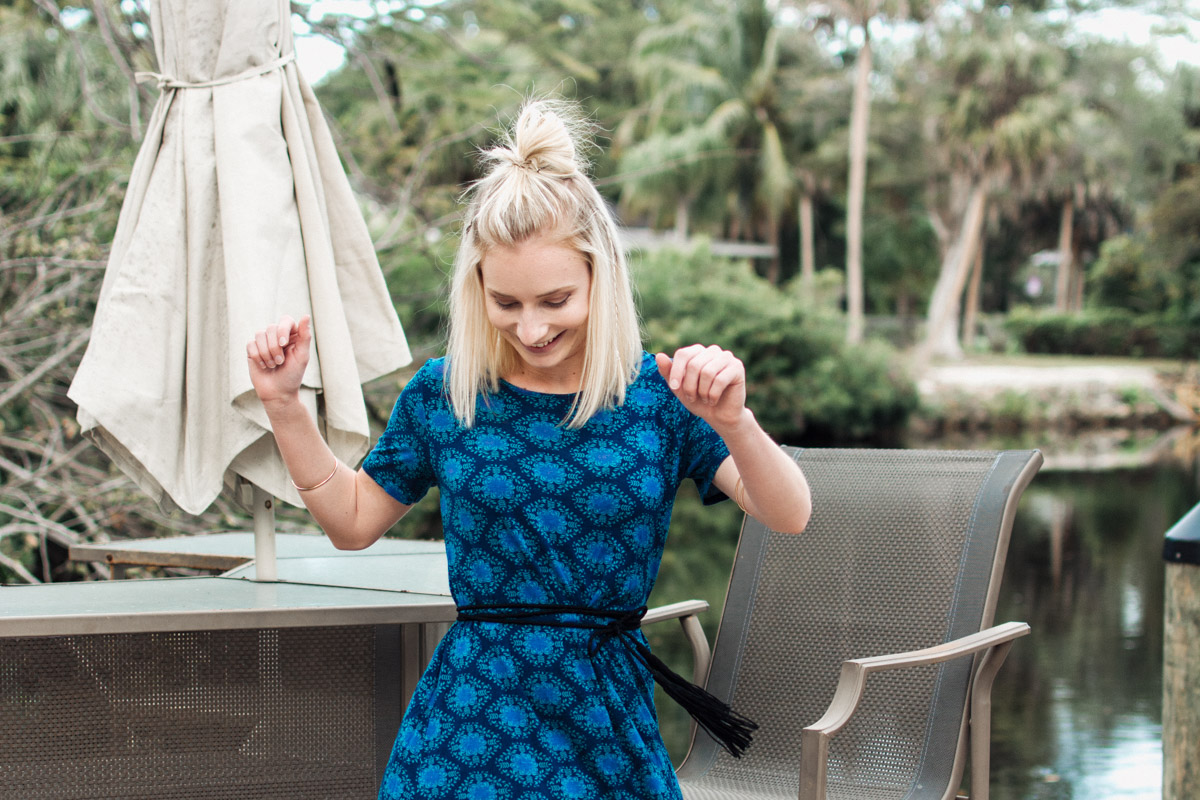 Jenny Bess of Sweet Teal twirling in a Natural Life dress