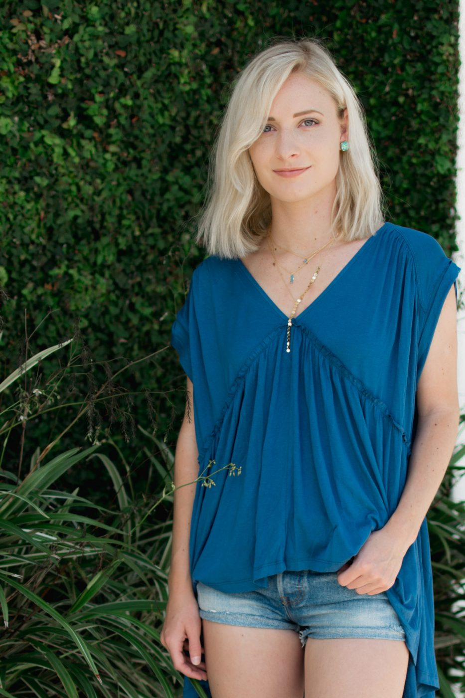 Sweet Teal's Jenny wearing Motif jewelry and GroopDealz top