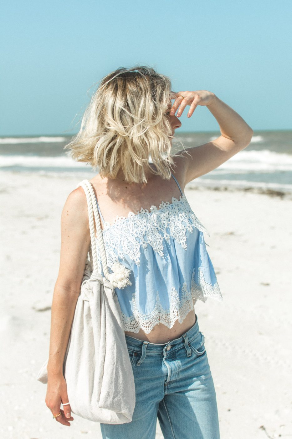 Jenny of Sweet Teal wearing jeans on the beach