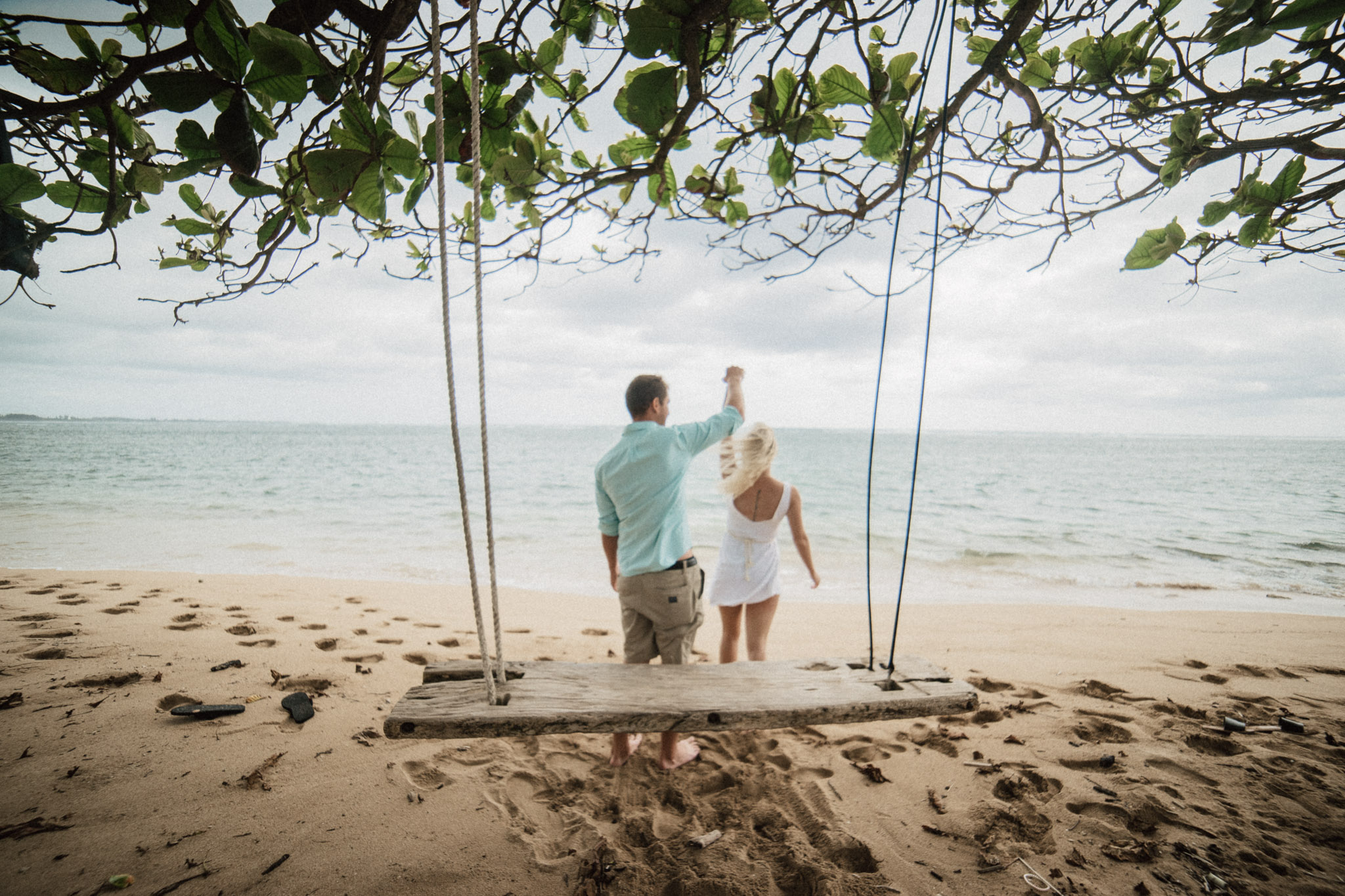 will and Jenny on a swing in Hawaii