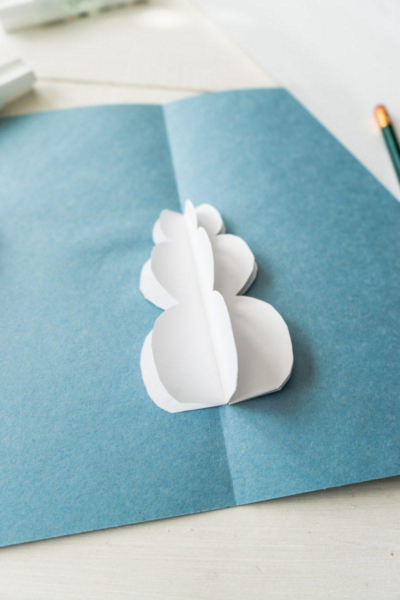 Glue snowman into card